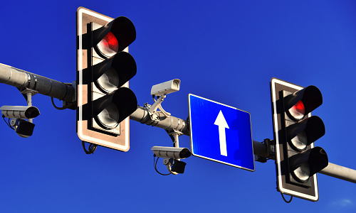 Traffic cameras and sensors on a traffic light
